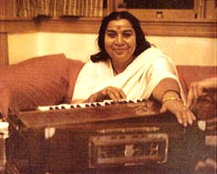 Shri Mataji Playing The Harmonium